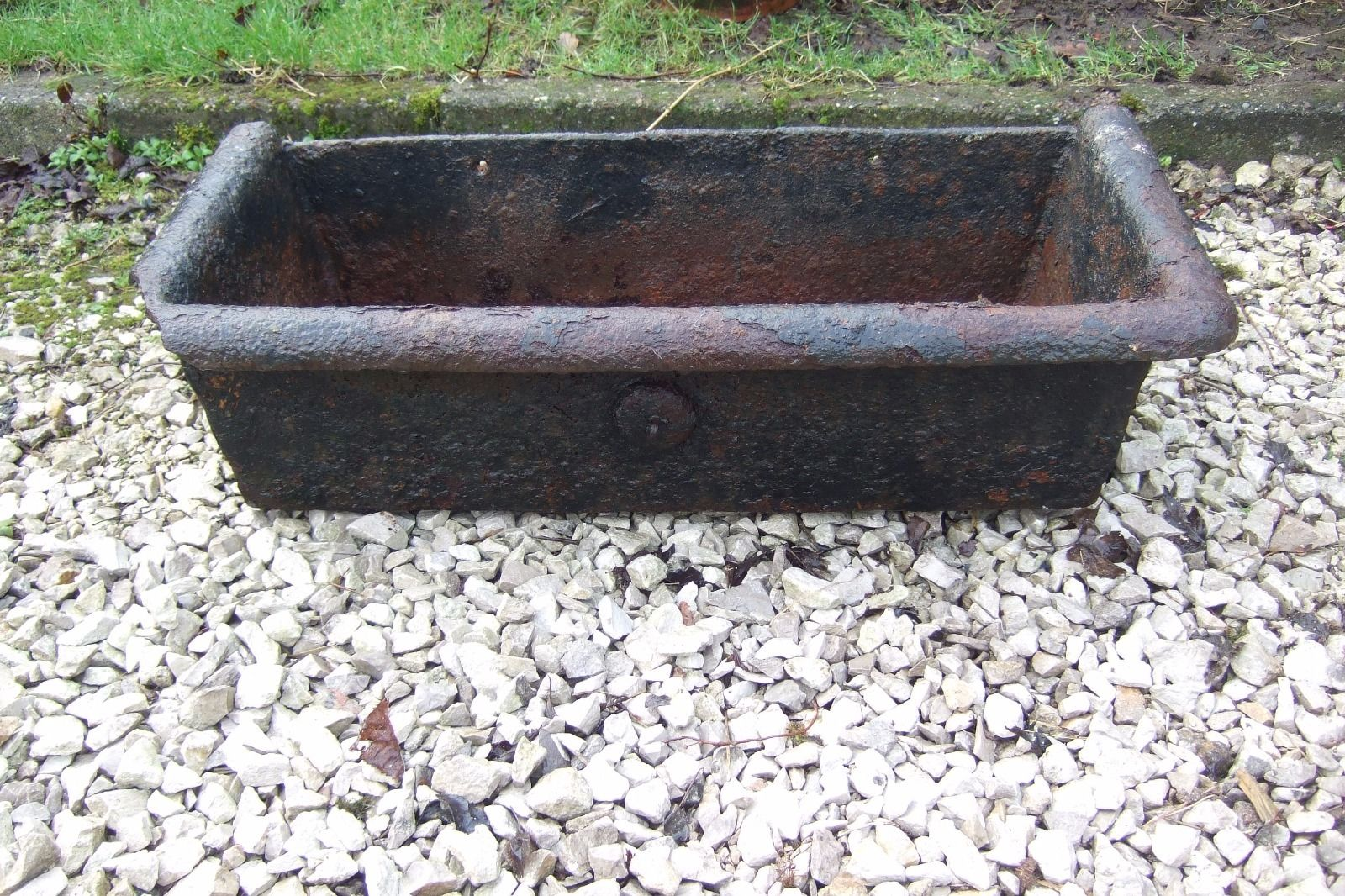 Cast iron water trough suitable for use as garden planter or water feature